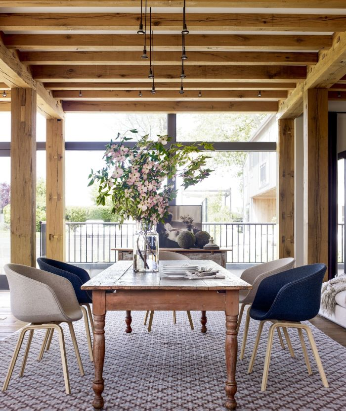 blue and gray chairs around table placed on colorful carpet farmhouse dining room decor exposed wood beams