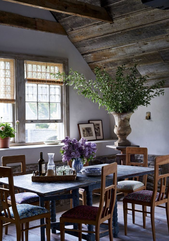 blue wooden table with vintage chairs exposed wood beams on the ceiling farmhouse dining room decor