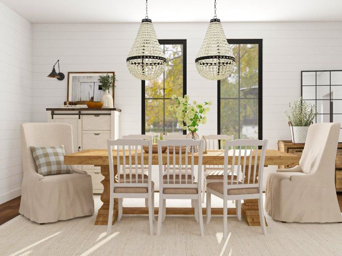 chandeliers hanging above long table white chairs and armchairs around it dining room design ideas