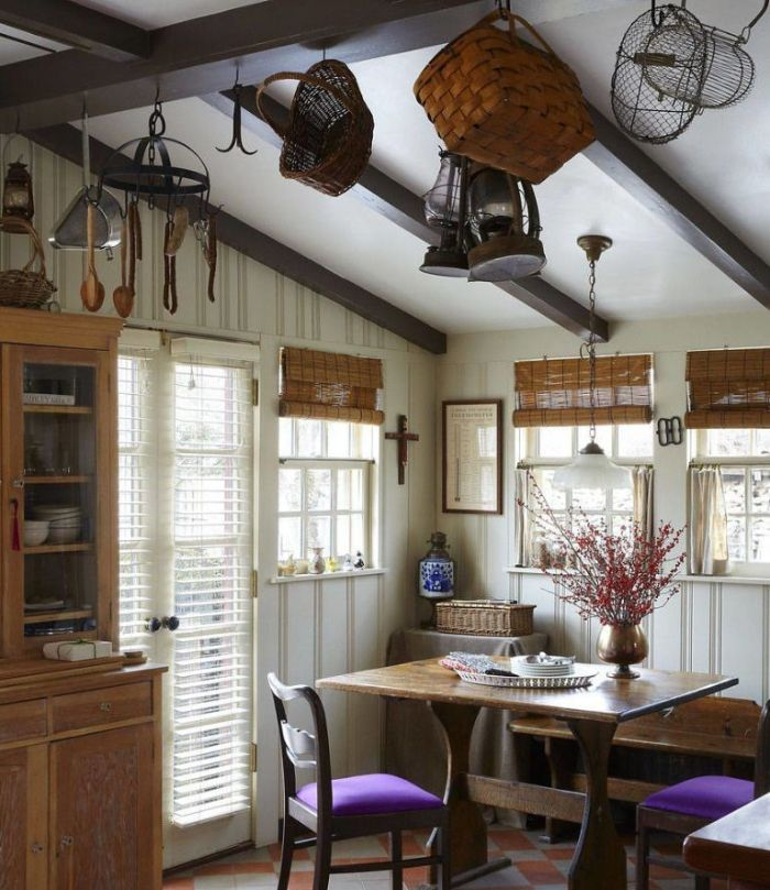 different baskets lanterns hanging from ceiling with exposed wood beams dining room table decor ideas purple chairs
