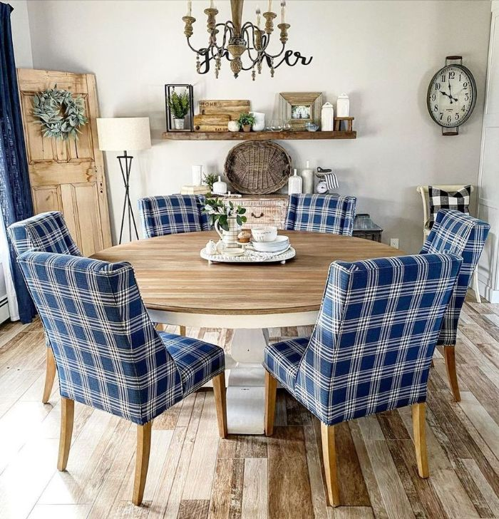 dining room table decor ideas blue chairs around round table open shelving on the wall