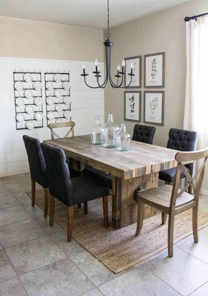dining room table decor three empty vases on table black chairs around it plates hanging on the wall