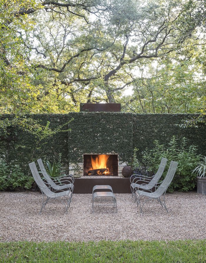 diy backyard ideas fireplace outside on wall covered with ivy four lounge chairs in front of it