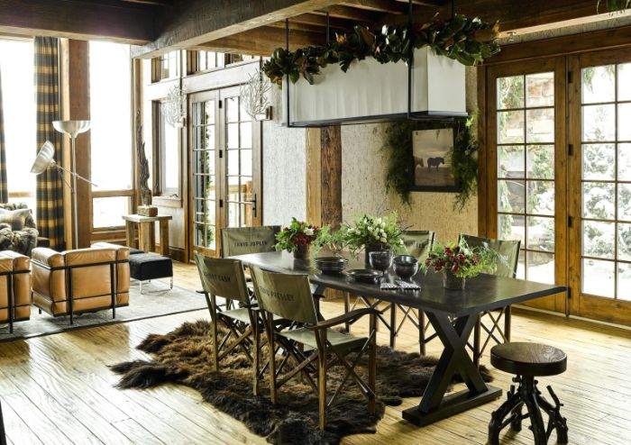 farmhouse dining room decor faux fur rug black wooden table with vintage chairs around it