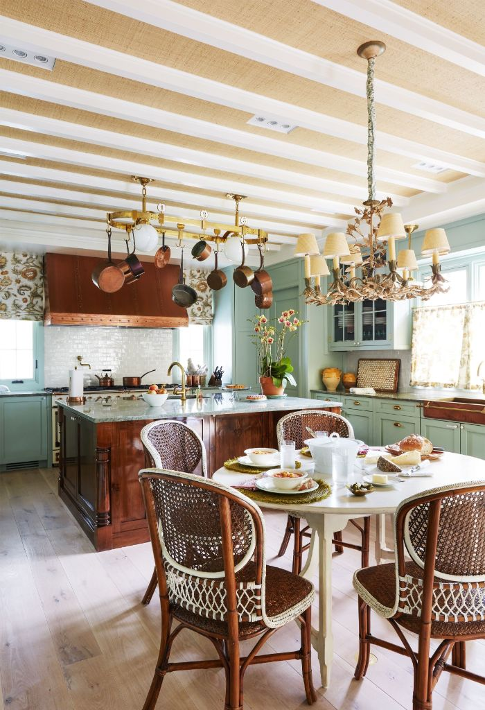 farmhouse kitchen table vintage chairs kitchen island pans hanging from the ceiling above
