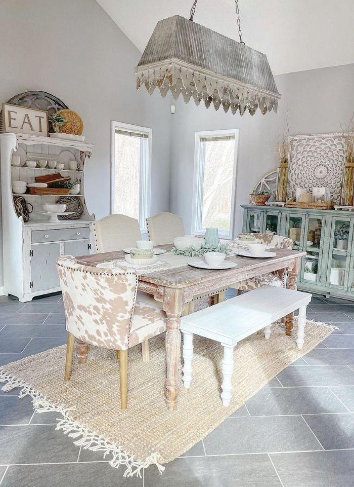 farmhouse table and chairs salvaged wood table bench and different chairs around it open shelving cupboards