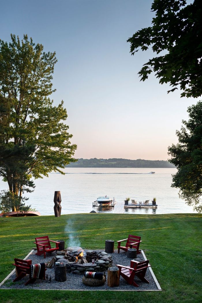 fire pit surrounded by four red wooden lounge chairs diy backyard ideas lake house