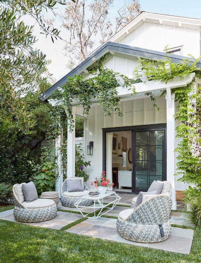 garden furniture four lounge chairs table placed in front of back door small backyard landscaping ideas