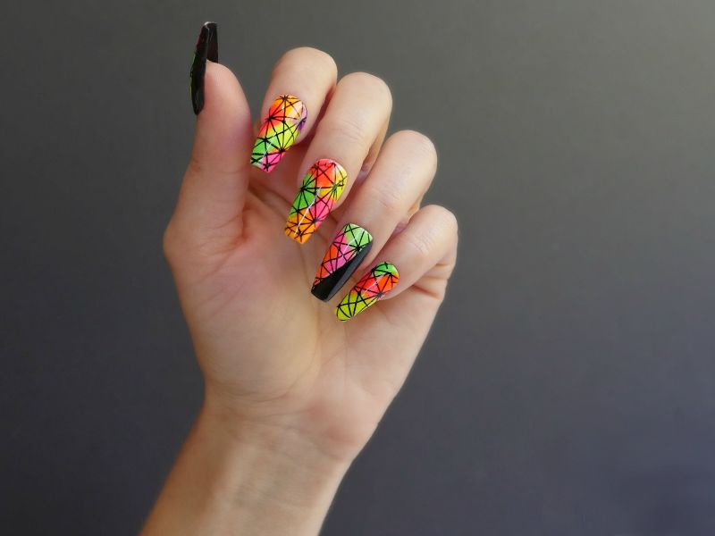 geometric design neon yellow nails with black