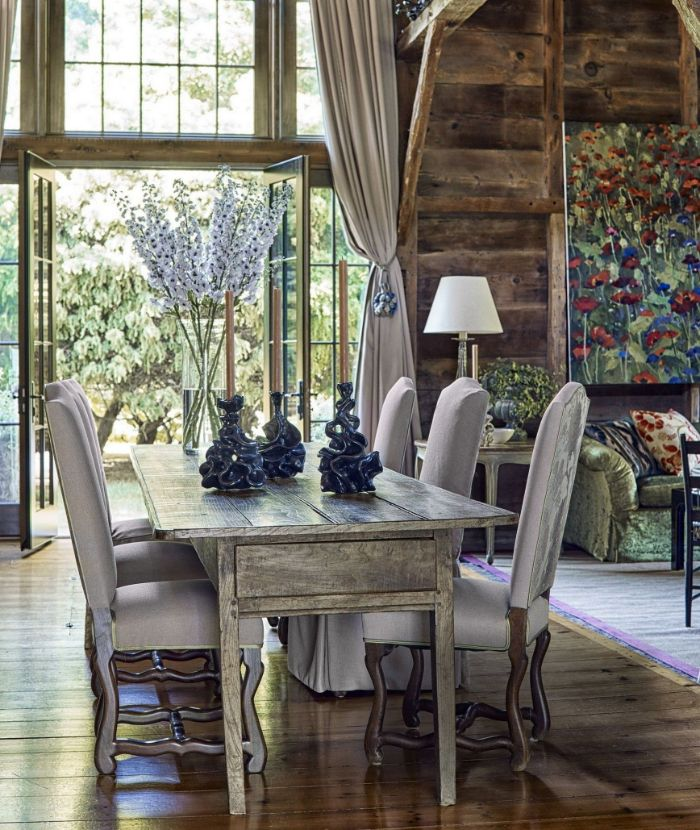 gray velvet chairs around wooden table farmhouse dining room vintage furniture large windows