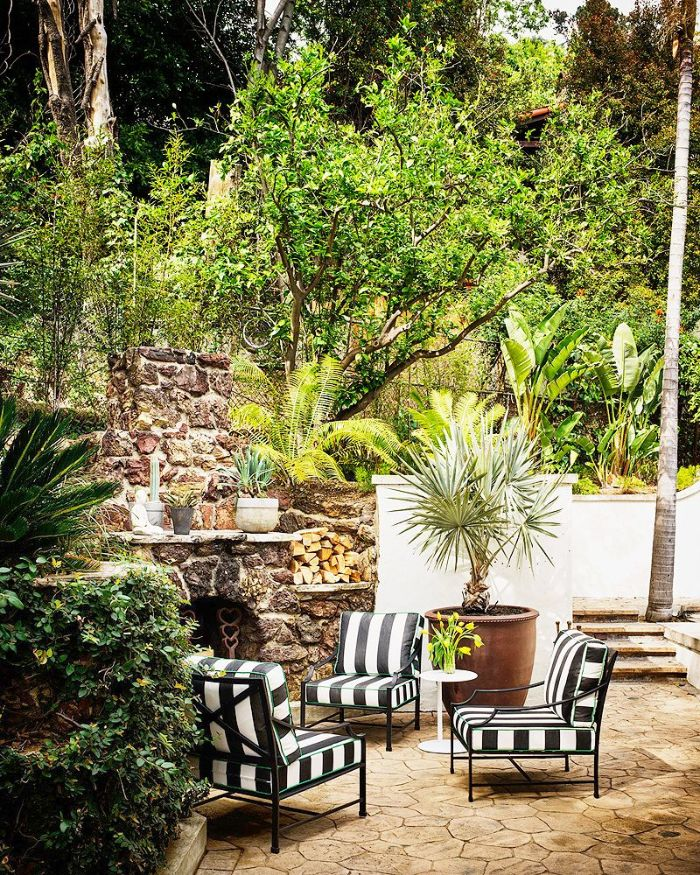 landscape design ideas three black and white chairs in front of stone fireplace surrounded by trees