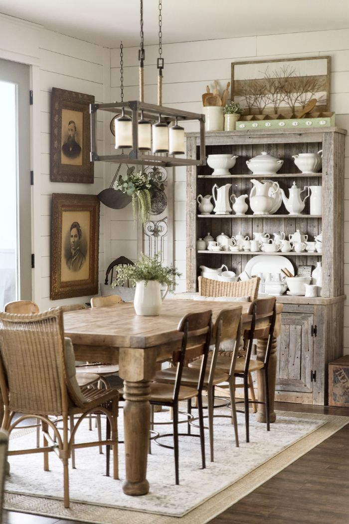 modern farmhouse dining room open shelving with china arranged on it next to wooden table and chairs