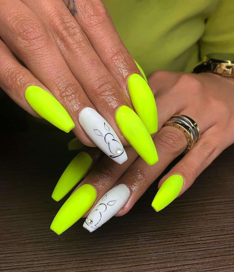neon yellow nails white bunny decorations