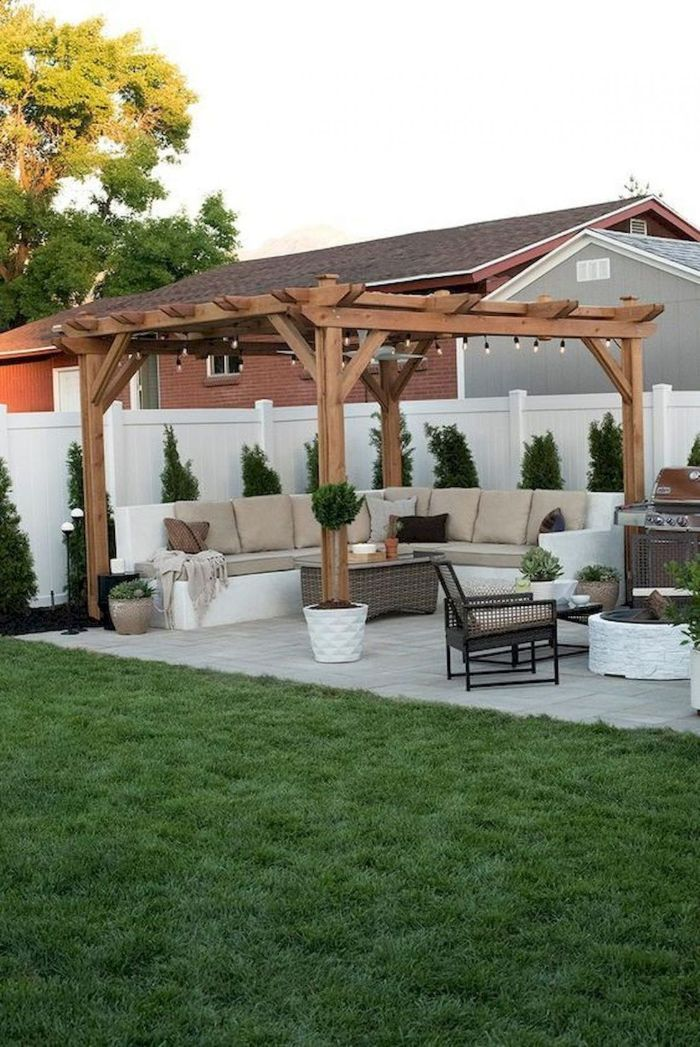 pergola with large sofa underneath rattan garden furniture small backyard landscaping ideas barbeccue on the side