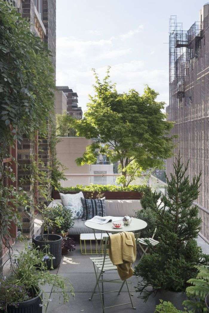 small backyard landscaping ideas small balcony with small gray sofa round table chairs lots of trees