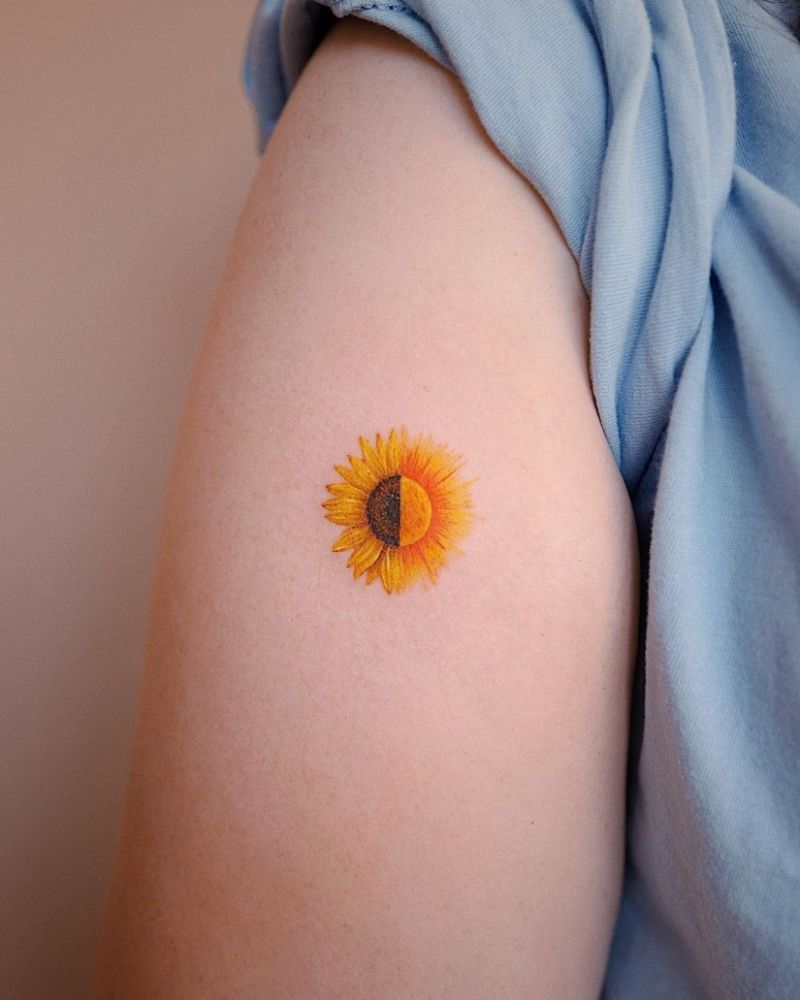 small sunflower tattoo on the side of shoulder