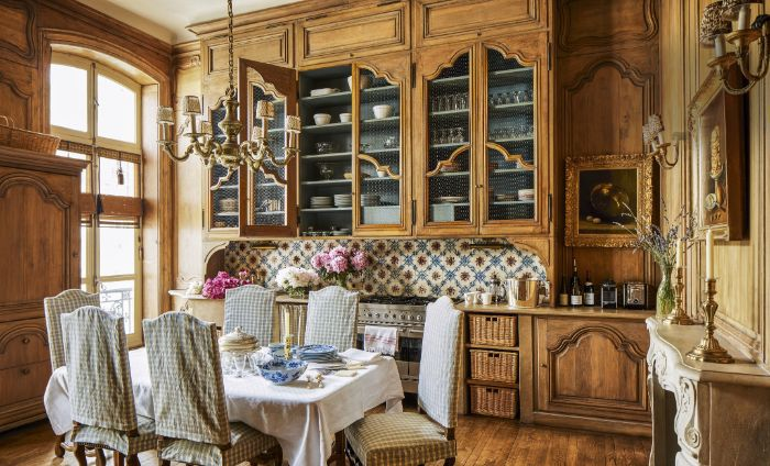 table and chairs covered with fabric vintage furniture farmhouse dining room kitchen backsplash with colorful tiles