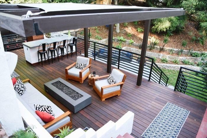 white cushions on wooden garden furniture arranged around fire pit backyard décor ideas large pergola