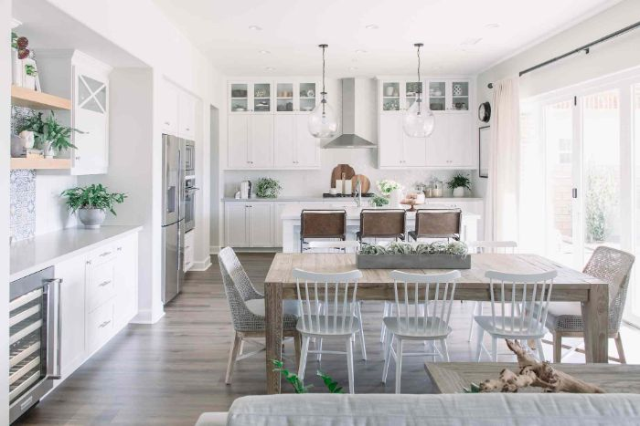 white walls cupboards and chairs around long table dining room table decor ideas kitchen island