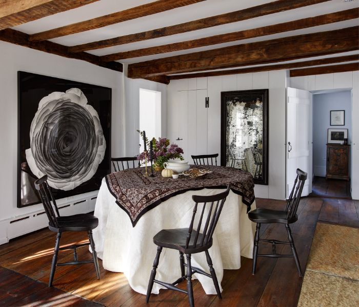 white walls with black art on them dining room design ideas table covered with table cloth black chairs