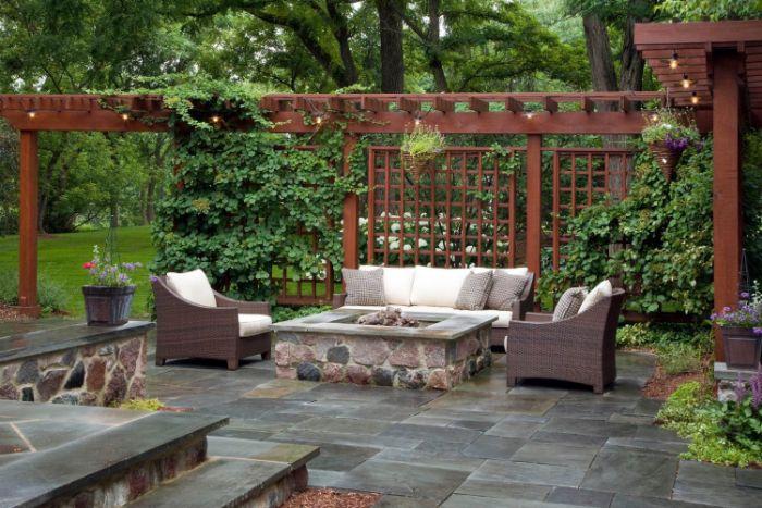 wooden pergola fire pit underneath with garden furniture around it backyard design ideas stone tiles on the floor