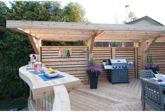 wooden pergola small backyard landscaping ideas barbecue and bar underneath dining area
