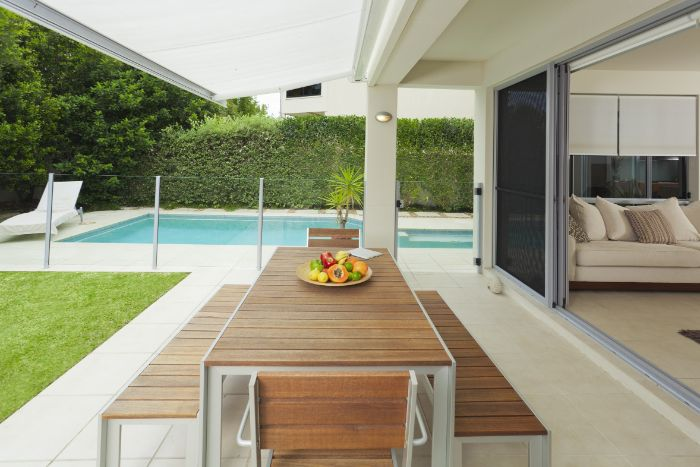 wooden table and two benches diy backyard ideas large pool and hedges for fence