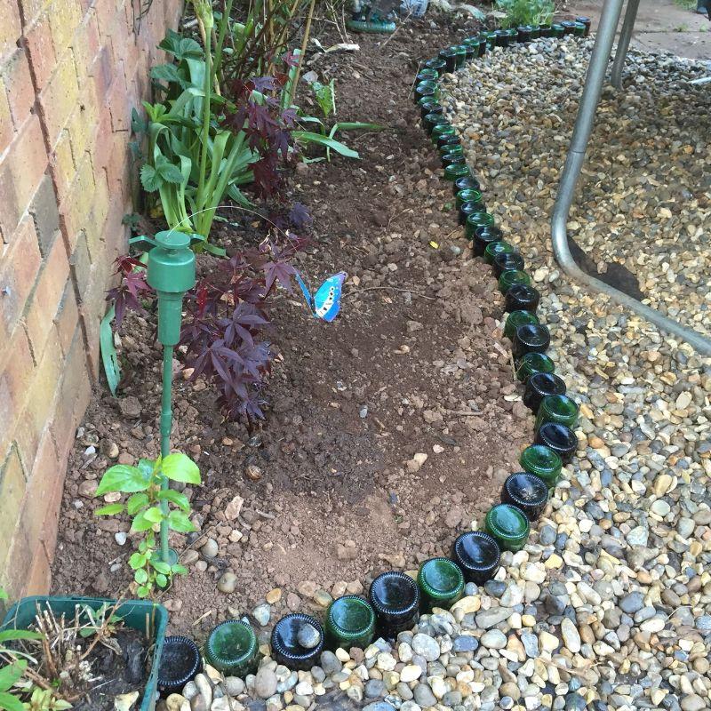 garden edging glass bottles into the ground