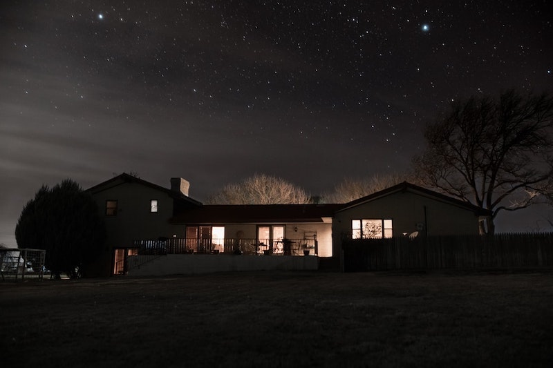 house during the night sky full of stars