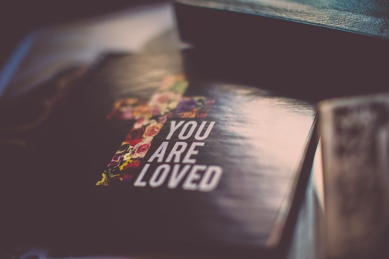 photo of bible with you are loved quote