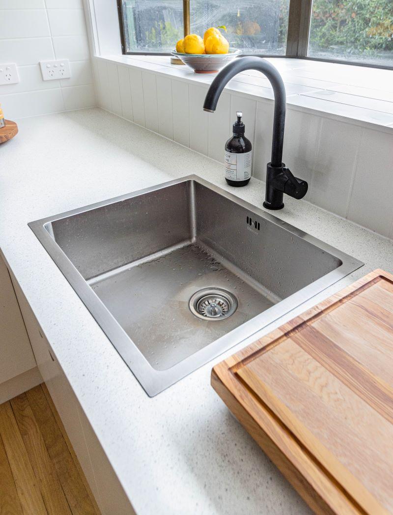 sstainless steel kitchen sink white countertops