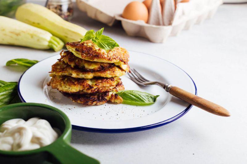 stacked zucchini patties white plate