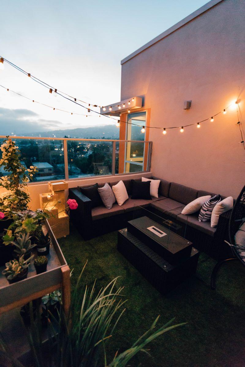 strings of fairy lights on balcony winter garden design ideas