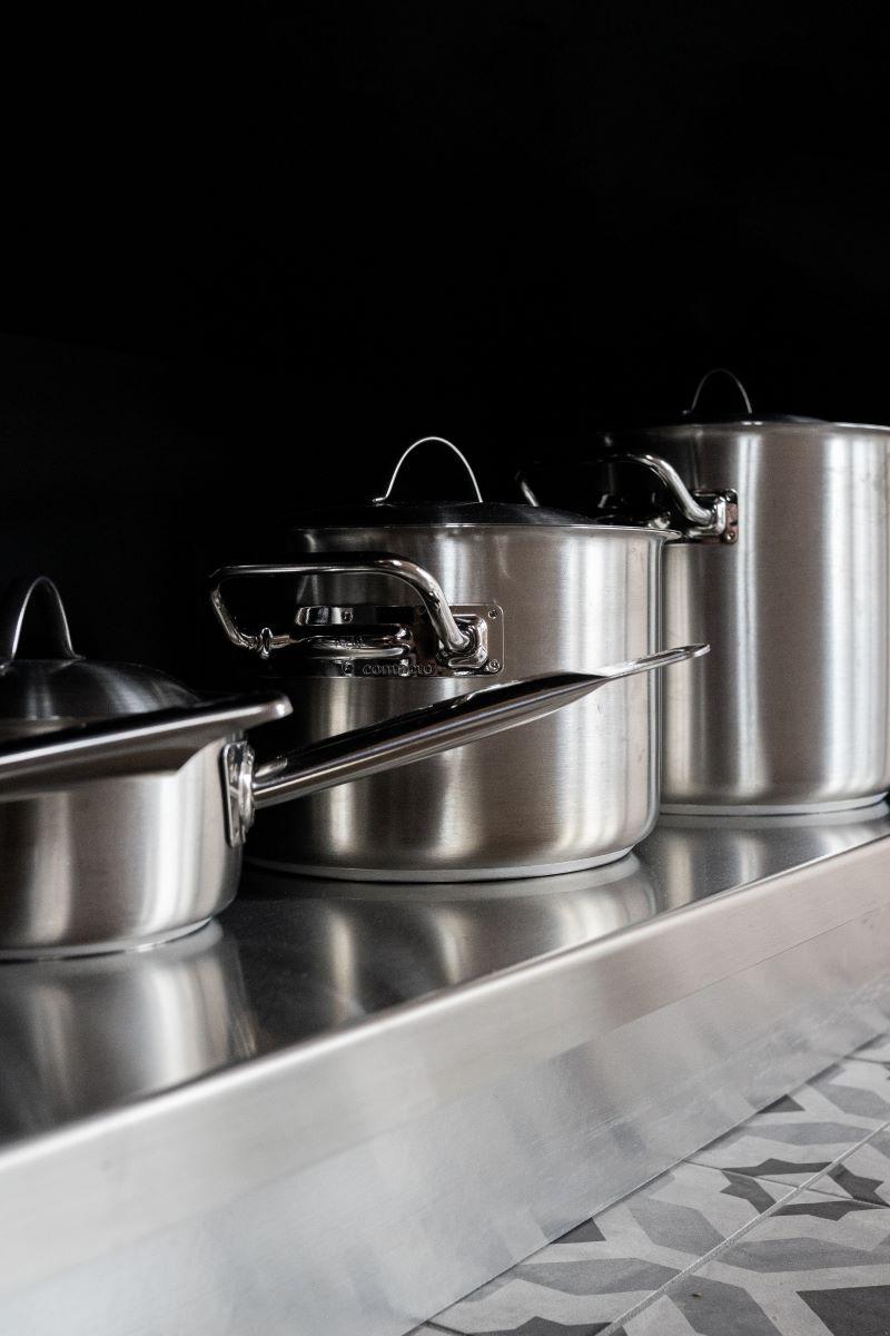 three steel pots steel kitchen colorful tiles