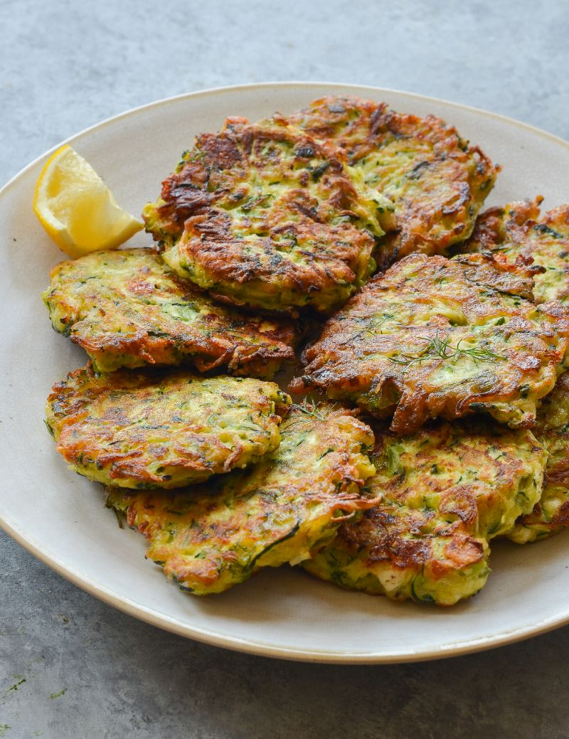 white plate with stacked zucchini patties