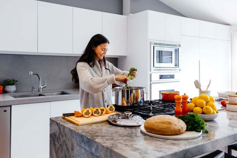 woman cooking plant based diets fresh fruits