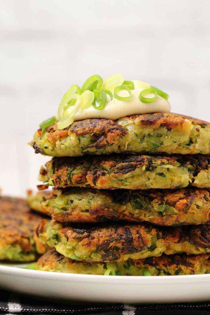 zucchini patties stacked with yogurt vegan