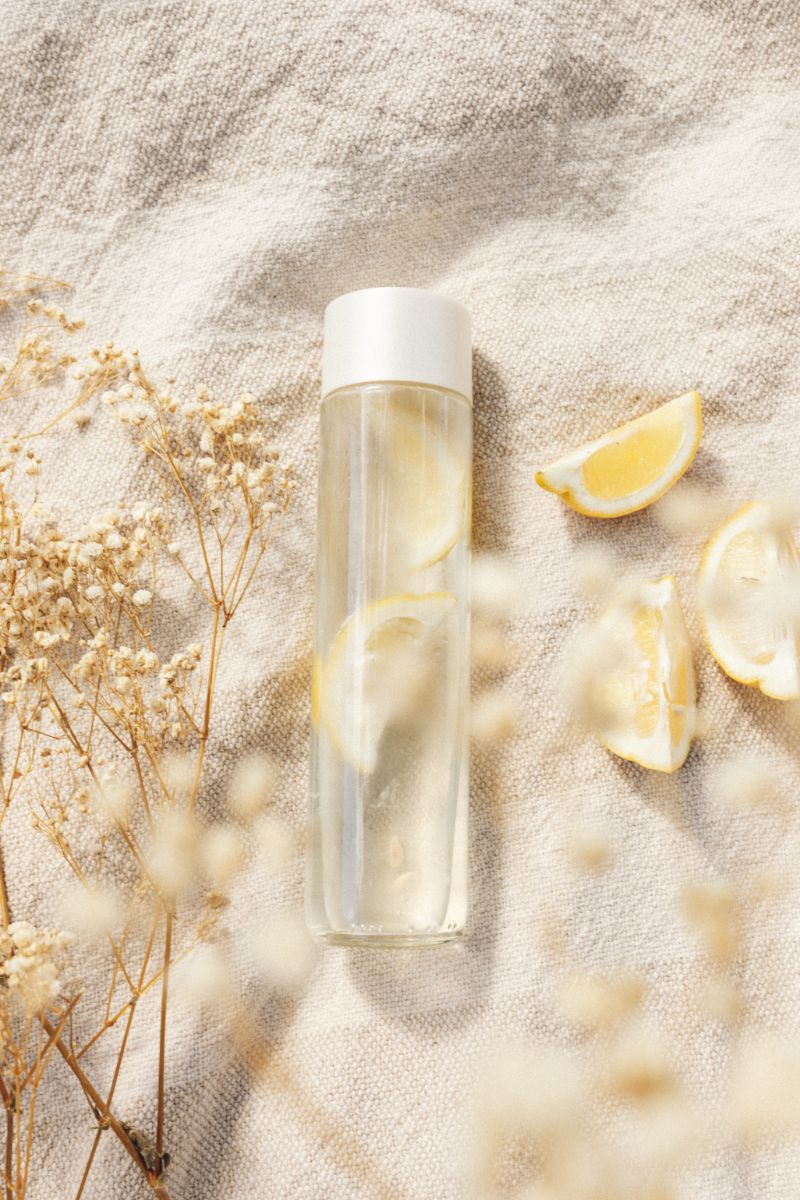bottle full of water benefits of lemon water with lemons