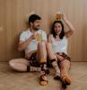 high socks with prints man woman sitting on floor