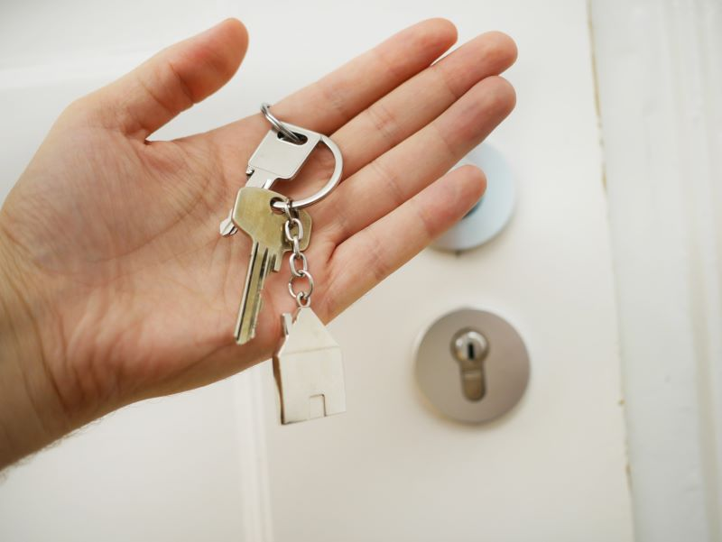 house keys in hand buying a home