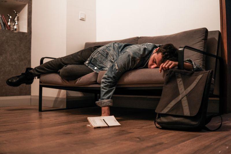 liver healing foods man laying on sofa