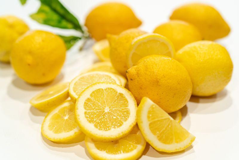 lots of sliced lemons benefits of lemon water