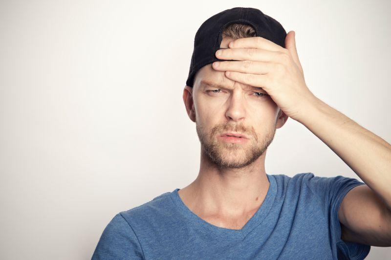 man holding his head liver healing foods headache