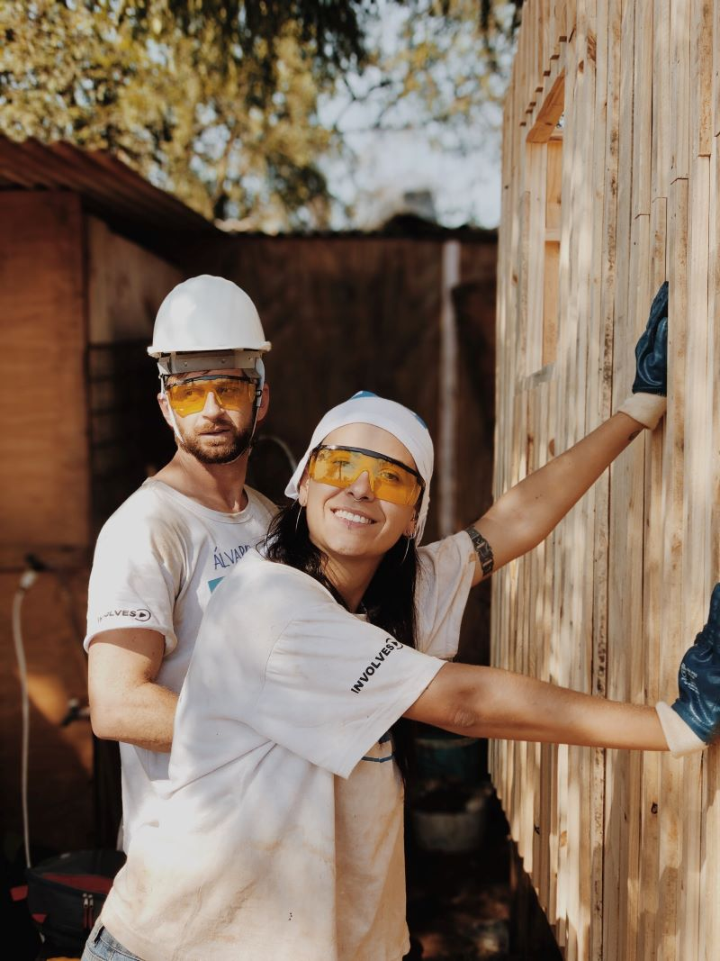 man woman with protective gear home improvements