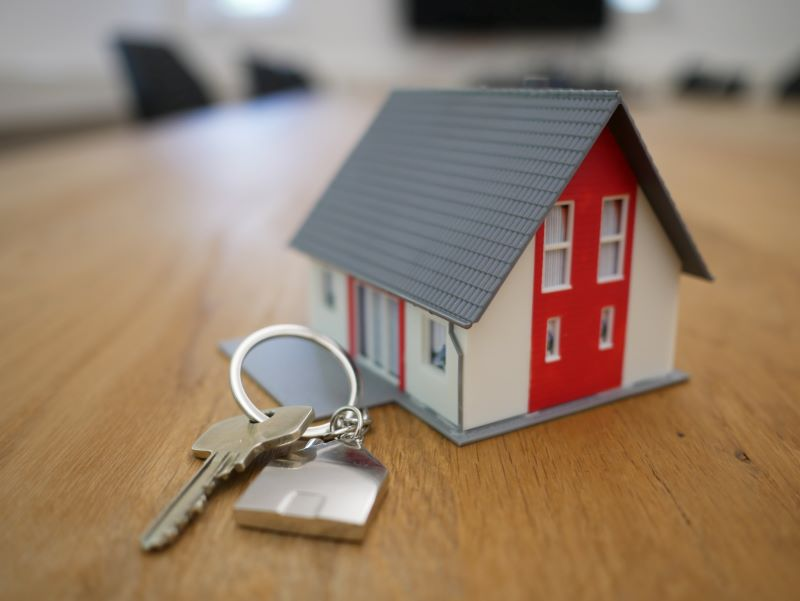 small toy house buying a home keys