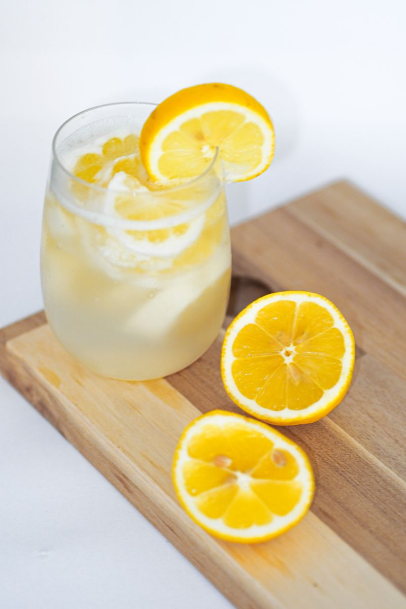 water in glass is lemon water good for you with lemon slices