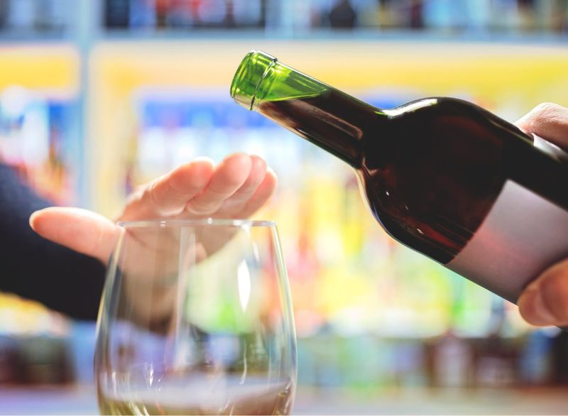 woman refusing alcohol how to cleanse your liver wine