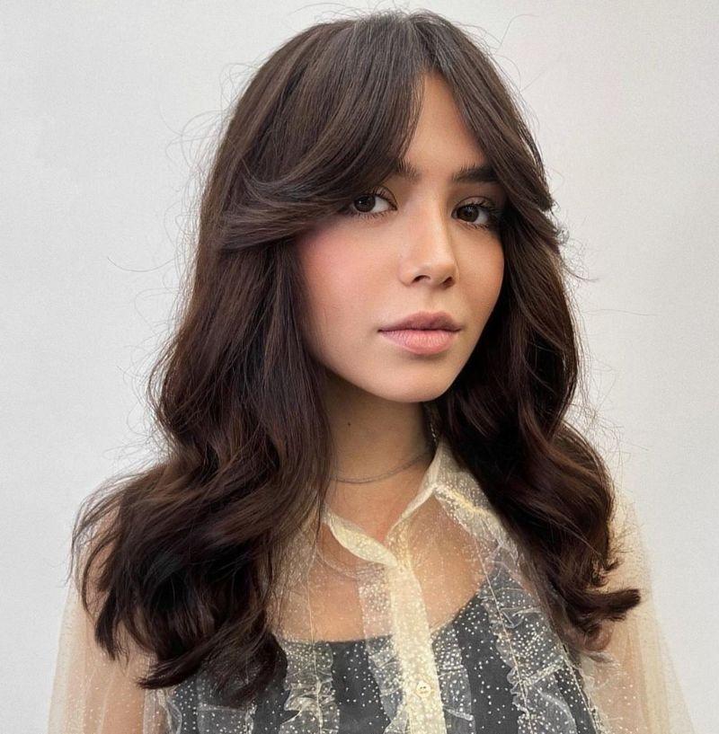curtain bangs wavy brunette hair