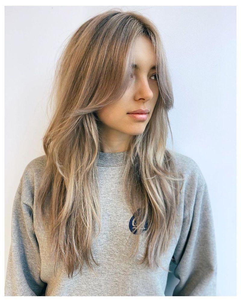 long blonde hair curtain bangs curly hair