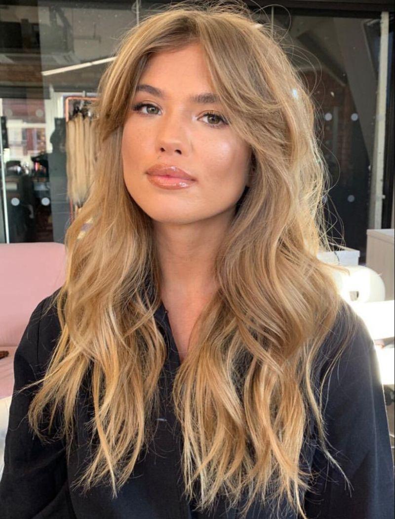 long blonde wavy curtain bangs straight hair
